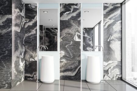 Interior of luxury bathroom with black marble walls, tiled floor, double freestanding sink and two large mirrors. 3d rendering