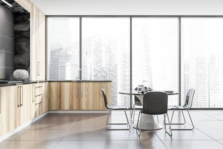 Interior of luxury panoramic kitchen with gray walls, tiled floor, wooden countertops with built in sink and coker and round marble table with chairs. 3d rendering Stock Photo