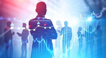 Silhouettes of business people over blurred background with double exposure of forex charts. Concept of teamwork, trading and international company. Toned image