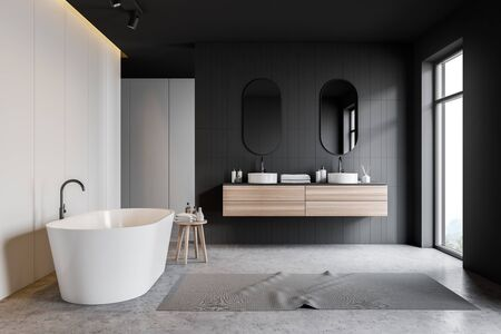 Interior of stylish bathroom with gray tile and white walls, concrete floor, double sink standing on wooden countertop, comfortable white bathtub and large window. 3d rendering Banco de Imagens