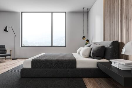 Side view of minimalistic bedroom with white and wooden walls, wooden floor, gray master bed with black bedside table and gray carpet. Comfortable armchair with floor lamp. 3d rendering