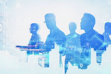Silhouettes of diverse business team members in blurred city with double exposure of network hologram and business interface. Concept of technology and communication. Toned image
