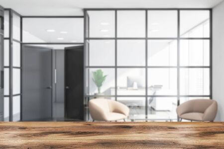 Blurred interior of modern office waiting room with white and glass walls, tiled floor, armchairs standing near glass coffee table and CEO office. Table for your product in foreground. 3d rendering 写真素材