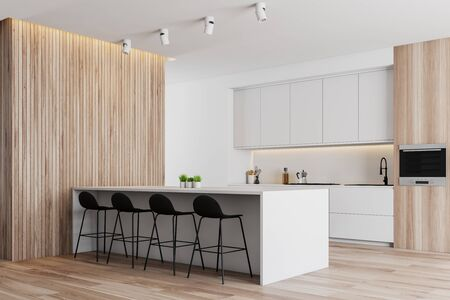 Corner of modern kitchen with white and wooden walls, wooden floor, white countertops and cupboards and white bar with stools. 3d rendering Reklamní fotografie