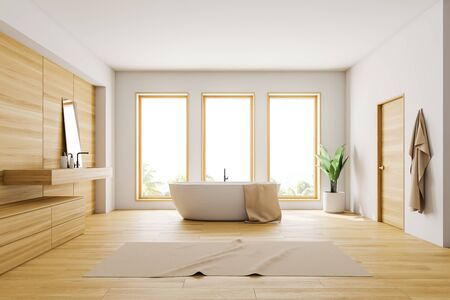 Interior of loft bathroom with white and wooden walls, wooden floor, white bathtub standing near three windows and wooden sink with mirror. 3d rendering Banco de Imagens