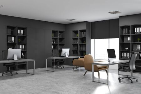 Corner of open space office with concrete floor, gray computer tables with armchairs for visitors and black bookcases with folders. 3d rendering Banco de Imagens