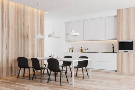 Corner of modern kitchen with white and wooden walls, white countertops and cupboards and dining table with black chairs. 3d rendering