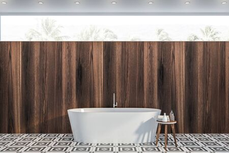 Interior of modern bathroom with dark wooden walls, tiled floor, white bathtub and chair with shampoos and towels. Narrow window. 3d rendering Banco de Imagens