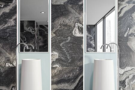 Close up of double bathroom sink with large mirrors above it standing in luxury room with black marble walls. 3d rendering