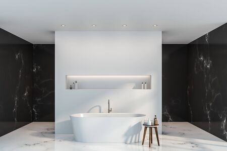 Interior of luxury bathroom with black marble and white walls, white marble floor, white bathtub with shelf above it and small chair with towels and shampoos. 3d rendering
