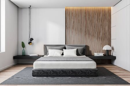 Interior of minimalistic bedroom with white and wooden walls, wooden floor, gray master bed with black bedside tables and gray carpet. 3d rendering Stok Fotoğraf