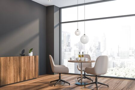 Corner of modern dining room in Scandinavian style with gray walls, wooden floor, round table with white chairs and comfortable cupboard. Panoramic window with cityscape. 3d rendering