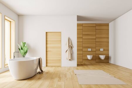 Interior of loft bathroom with white walls, wooden floor and white bathtub with towel on it standing under windows. Door in the wall and two toilets. 3d rendering