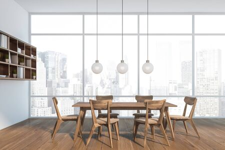 Side view of modern dining room with white walls, wooden floor, dark wooden table with chairs and bookshelves on the wall. 3d rendering Stock Photo