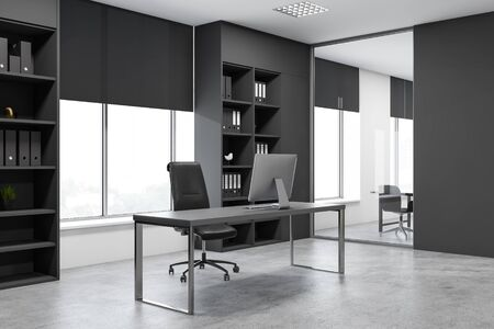 Corner of modern office with concrete floor, large window, gray computer table and dark gray bookcases with folders. Concept of management. 3d rendering Stock Photo