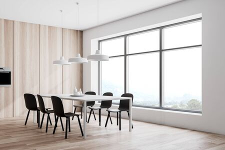 Interior of modern kitchen and dining room with white and wooden walls, wooden floor, oven and white table with chairs. 3d rendering