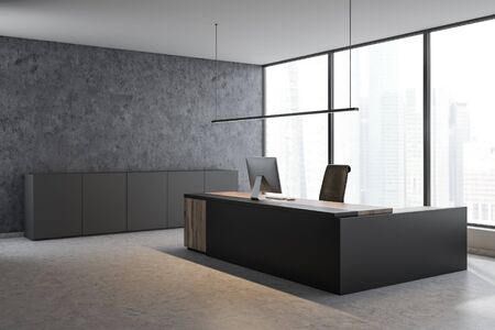 Corner of panoramic CEO office with concrete walls and floor, gray and wooden computer table and gray cabinets. Concept of leadership. 3d rendering