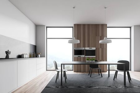 Loft kitchen interior with white and gray walls, wooden floor, white countertops with built in cooker, dining table on gray carpet and two ovens in wooden cupboard. 3d rendering