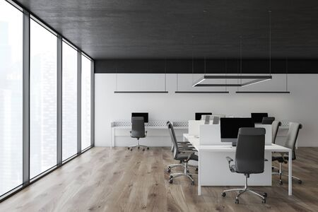 Interior of panoramic open space office with white walls, black ceiling, wooden floor and rows of white computer tables with gray chairs. Concept of teamwork. 3d rendering