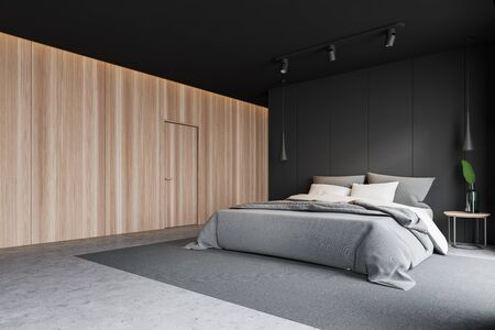 Corner of modern master bedroom with gray and wooden walls, concrete floor, double bed standing on gray carpet, bedside table with plant on it and wooden door. 3d rendering