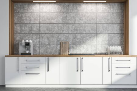Close up of white kitchen countertop with built in cooker and modern coffee machine standing in stylish kitchen with concrete walls. 3d rendering Standard-Bild - 124975147