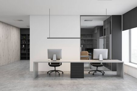 Interior of modern office with white and wooden walls, concrete floor and long white computer table with two desktops. Black bookcases with folders in background. 3d rendering