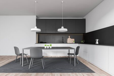 Interior of minimalistic kitchen with white and gray walls, wooden floor, white countertops, black cupboards and gray table with chairs on carpet. 3d rendering