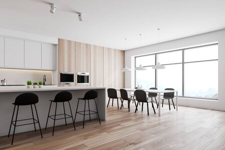 Corner of modern kitchen with white and wooden walls, wooden floor, white countertops and cupboards, dining table with black chairs and white bar with stools. 3d rendering