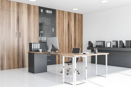 Corner of CEO office with white walls, tiled floor, wooden computer table, bookcase and gray shelf with folders. 3d rendering Stok Fotoğraf