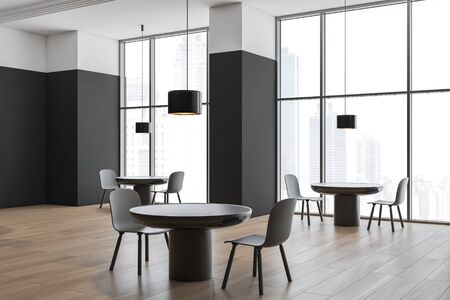 Corner of minimalistic cafe with white and black walls, wooden floor, large windows and round tables with gray chairs. 3d rendering Stok Fotoğraf