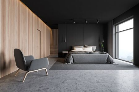 Interior of stylish master bedroom with gray and wooden walls, concrete floor, double bed on gray carpet, comfortable gray armchair and wooden cabinet in background. 3d rendering Stok Fotoğraf