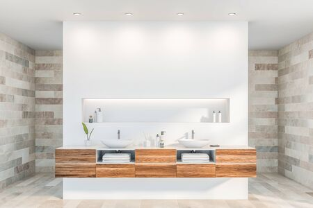 Interior of luxury bathroom with tiled and white walls, double sink standing on wooden countertop and shelf with creams above it. 3d rendering