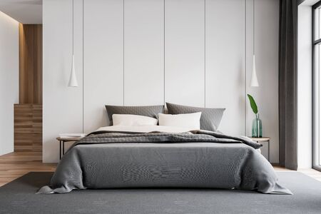 Interior of stylish master bedroom with white walls, wooden floor, double bed on gray carpet, two bedside tables with books and plant and wooden cabinet in background. 3d rendering Foto de archivo