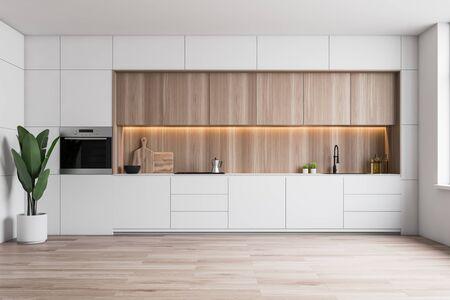 Interior de cocina minimalista con paredes blancas, piso de madera, encimeras blancas con fregadero y vitrocerámica, alacenas de madera y horno empotrado. Representación 3d