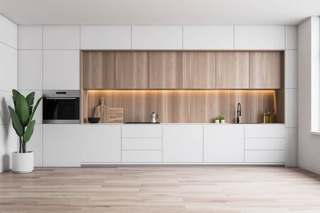 Wnętrze minimalistycznej kuchni z białymi ścianami, drewnianą podłogą, białymi blatami ze zlewozmywakiem i kuchenką, drewnianymi szafkami i wbudowanym piekarnikiem. renderowanie 3d