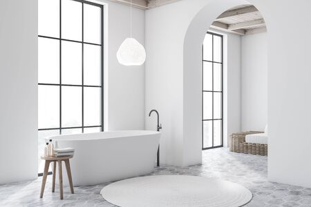 Corner of modern bathroom with white walls, tiled floor, white bathtub and living room with sofa in background. 3d rendering