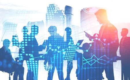Silhouettes of business people walking and communicating over cityscape background with double exposure of infographics and planet hologram. Concept of hi tech. Toned image Stock fotó
