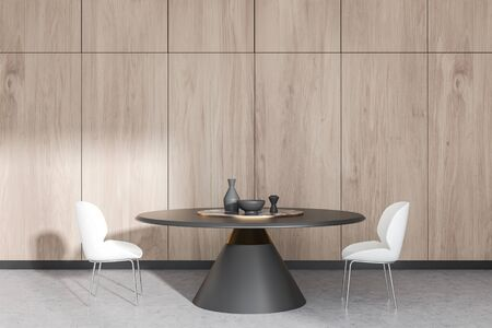 Interior of modern dining room with wooden walls, concrete floor, round dining table and white chairs standing near it. 3d rendering Stock Photo - 128361637