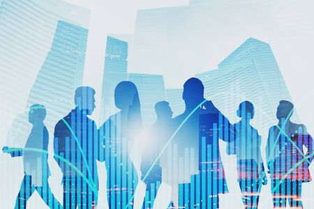Silhouettes of business people communicating in modern city with double exposure of graphs. Concept of teamwork and stock market. Toned image Stock fotó