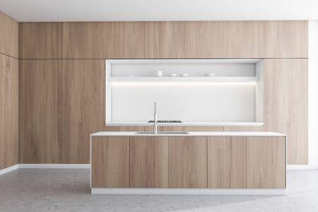 Innenraum der modernen Küche mit weißen und hölzernen Wänden, Betonboden, Holzarbeitsplatten mit eingebautem Ofen und weißer Insel mit Spüle. 3D-Rendering