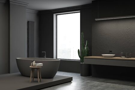 Corner of loft bathroom with grey walls, tiled and gray floor, comfortable gray bathtub and white sink standing on wooden countertop. 3d rendering Stock Photo