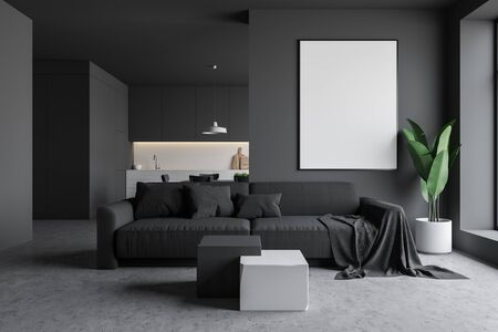 Interior of gray living room with concrete floor, gray sofa, coffee table, vertical mock up poster frame and kitchen in background. 3d rendering