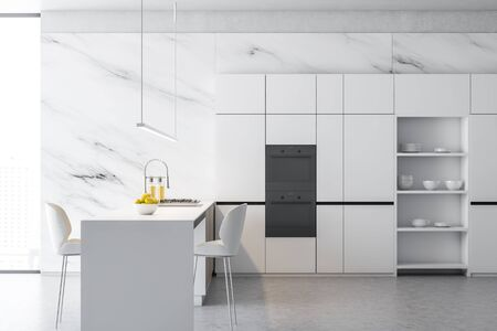 Side view of stylish kitchen interior with white marble walls, concrete floor, white cupboards with dishes and two ovens and white island with cooker, sink and two stools. 3d rendering Archivio Fotografico - 127789291