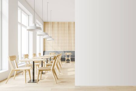 Interior of minimalistic cafe with white and wooden walls, wooden floor, comfortable sofa and wooden tables with chairs. Mock up wall to the right. 3d rendering