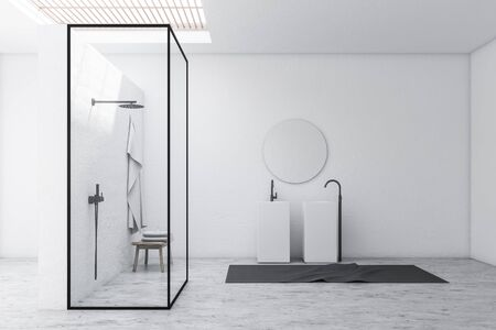 Corner of stylish bathroom with white walls, stone floor, shower stall with glass walls and double sink with round mirror above it. 3d rendering