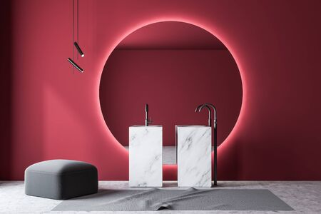 Interior of modern bathroom with red walls, concrete floor, marble double sink and large round mirror with gray pouffe. 3d rendering