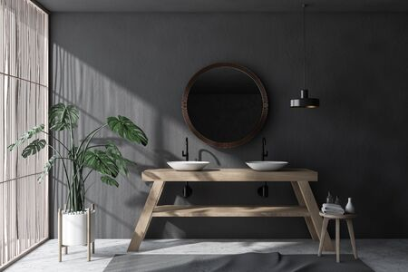Interior of minimalistic bathroom with gray walls, concrete floor, light wooden blinds, double sink standing on wooden countertop and round mirror. 3d rendering 写真素材