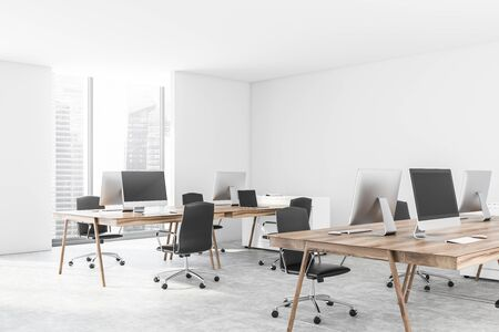 Corner of minimalistic open space office with white walls, concrete floor, wooden computer tables with black chairs and window with cityscape. 3d rendering Stockfoto