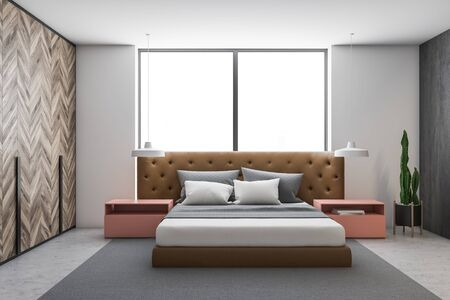 Interior of stylish bedroom with white and gray walls, concrete floor, leather master bed with pink bedside tables and stylish lamps and large window. 3d rendering