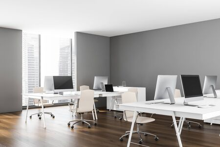 Corner of minimalistic open space office with gray walls, wooden floor, white computer tables with white chairs and window with cityscape. 3d rendering